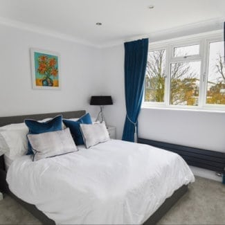 Made to measure bedroom curtains London fitted on a pole in Kensington