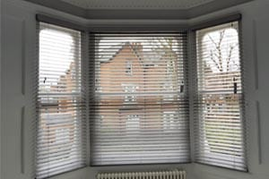 Grey Made To Measure Wooden Blinds in a Bay Window