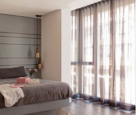 A bedroom voile made in a Wave curtain hung on a Silent Gliss 3840 track