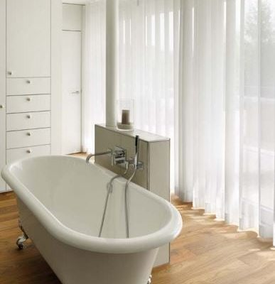 A light weight voile made in a Wave curtain hung on ceiling fitted Silent Gliss 3840 track