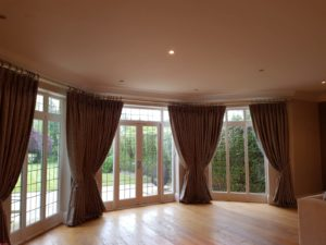 Bay Window curtains on a bespoke pole, the very top end of handsewn interlined curtains
