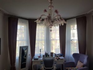 Blackout bedroom curtains with soft voiles behind