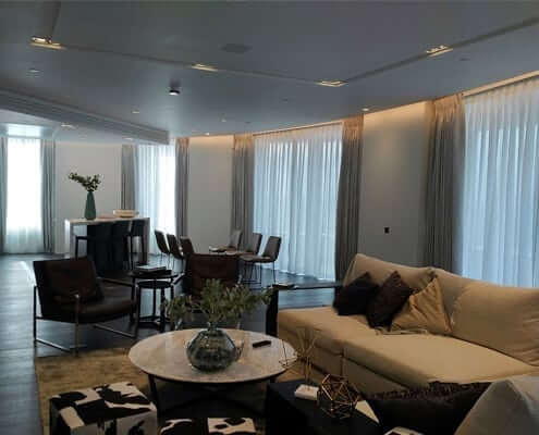 Curtains London Riverside Flat. 6 Pinch pleat curtains for a cirved moden apartment overlooking the city with ceiling fitted tracks