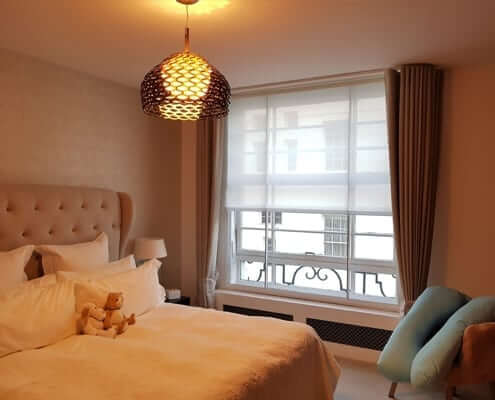 Curtains London in Belgravia. Wave curtains and roller blind behind in a lovely modern bedroom