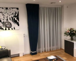 Finsbury Park Blue Velvet Curtains London. Pinch pleat curtains and a voile fitted behind for privacy