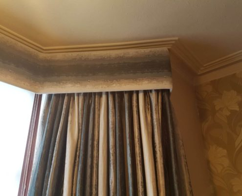 Pinch pleat made to measure curtains inside a bespoke curtain pelmet in a north London flat