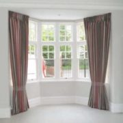 Pinch pleat curtains on a bay window on a ceiling fitted track in North London