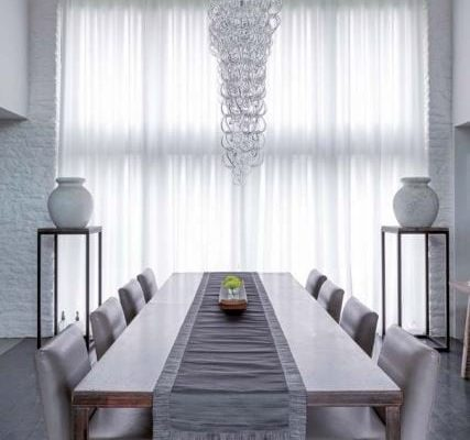 Wave curtain hung on ceiling fitted Silent Gliss 3840 track in a light voile fabric