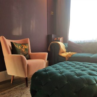 Amazing cinema room bespoke ottoman and pink velvet chair with purple curtains in London Fitzrovia