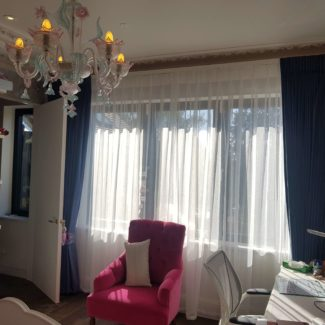 Bay window curtains in London Fitzrovia in a blue velvet with made to measure voile behind i