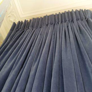 Blue velvet pinch pleat curtains in London Kings Cross