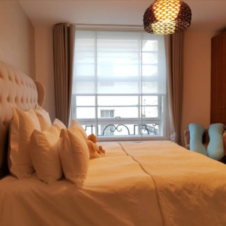 London Mayfair Wave headed Curtains Fited with Bespoke Blind in Bedroom