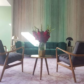 Lovely bespoke wallcovering with green velvet sofa with curtains in London Kings Cross