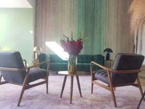 Lovely bespoke wallcovering with green velvet sofa with curtains in Mill Hill