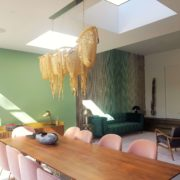Lovely interiors, handmade green velvet sofa with floor to ceiling velvet curtains in London, Ealing