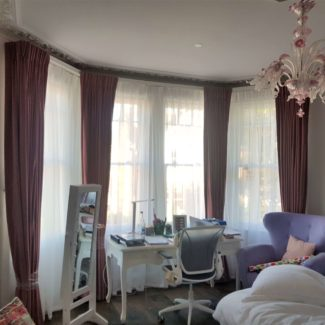 Lovely velvet bedroom blackout curtains in London Fitzrovia on a made to measure track and pelmet board