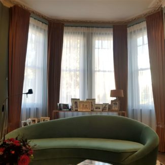 Velvet curtains in London Fitzrovia fitted on a bespoke bay track