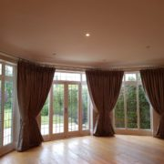 Wide bay window eyelet curtains on a bespoke pole in London, Barnet