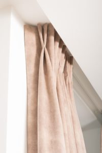 Close up of double pinch pleat showing returns against the wall