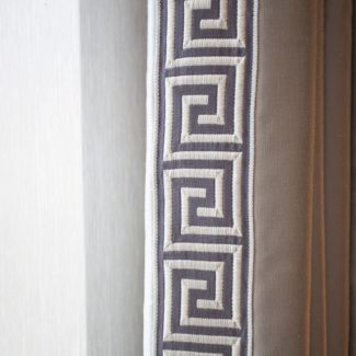 Hand-sewn inset border on the interlined curtains