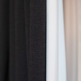 Grey linen fabric showing the 3-pass blackout lining